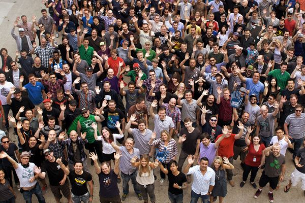 team shot from above with hundreds of Ubisoft Toronto employees waving