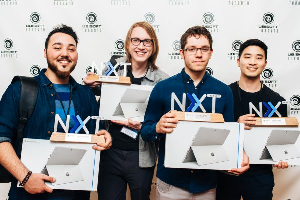 Winners of the Ubisoft Toronto NXT Showcase 2017 hold up their trophies