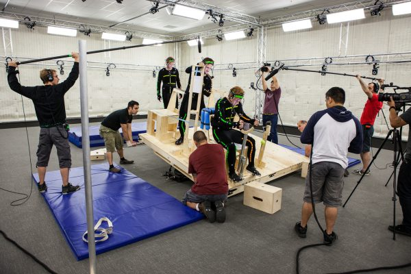 motion captures studio on large rig surrounded by sound and video crew in performance capture studio