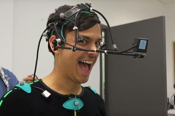 Asap Science cast in the performance capture studio with a face movement capture rig on their head