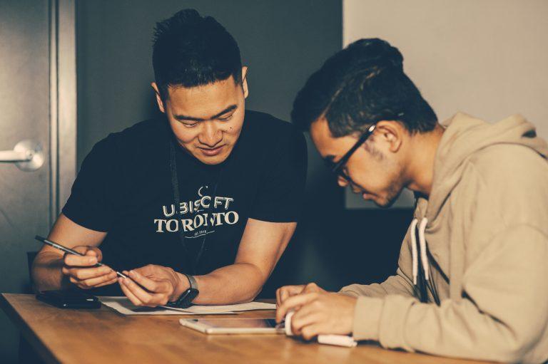 Ubisoft Toronto Employee reviews a student's portfolio
