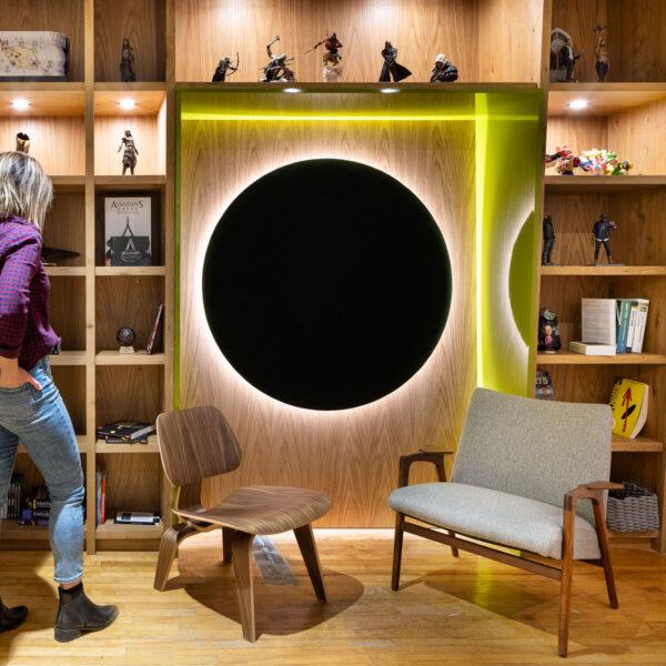 Ubisoft Winnipeg Woman Standing at a bookcase